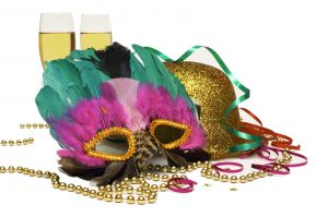 Feathered mask, hat, beads and champagne in Gold, Green and Purple for Mardi Gras