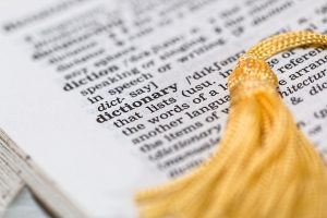 An image of a book highlighting the word Dictionary