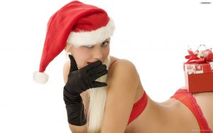 Sexy lady in Santa Hat and a wrapped gift